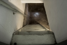 looking down the stairs at unfinished basement
