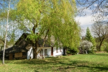 Home surrounded by spring trees and blossoms