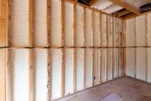 spray foam insulation between studs on wall