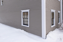 exterior corner of house during snowy winter