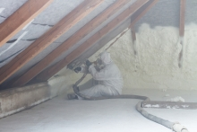 spray foam being installed in attic of home