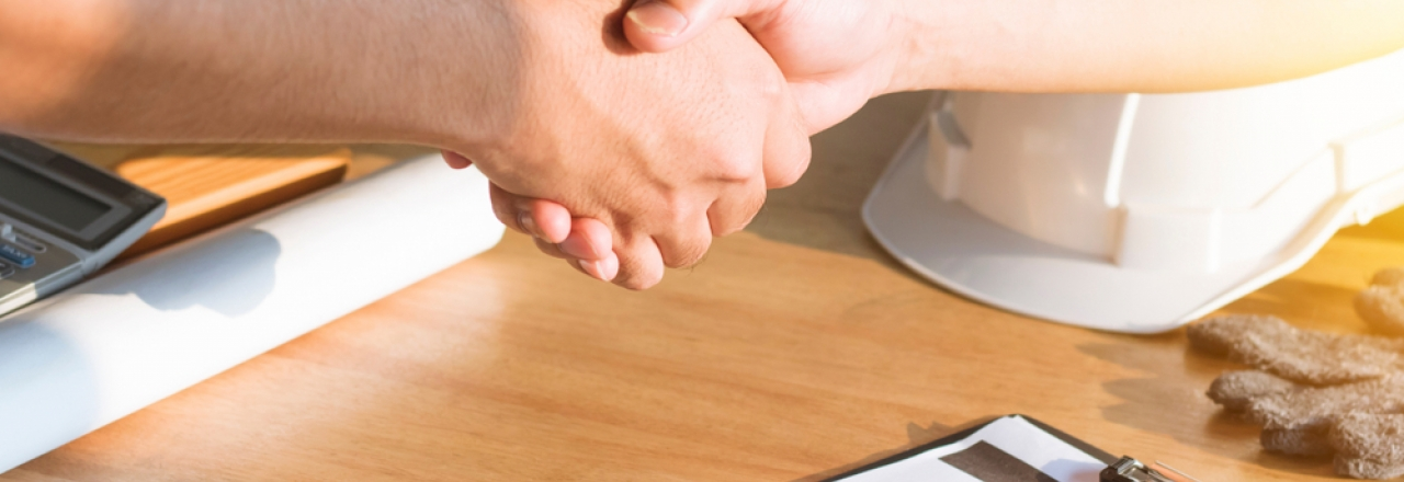 homeowner shaking hands with contracted worker