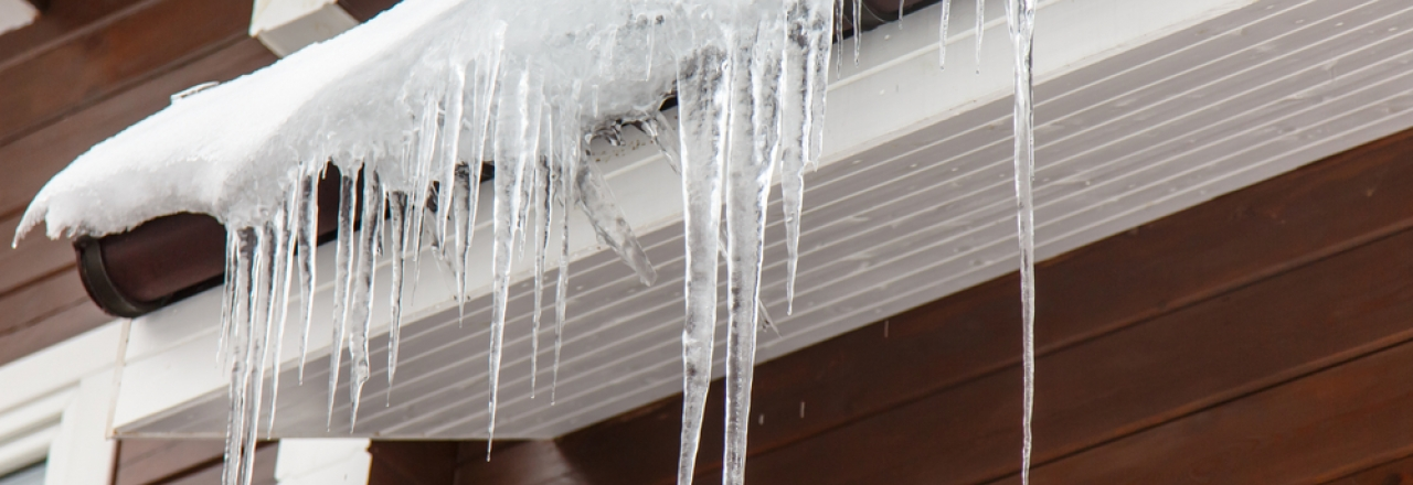 icicles and snow on edge of roof