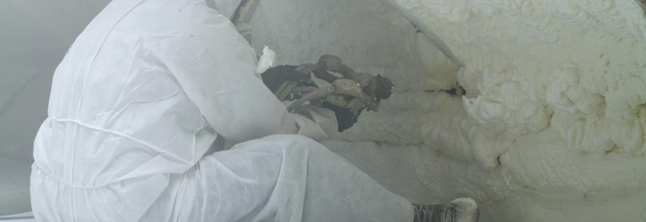 worker installing spray foam insulation
