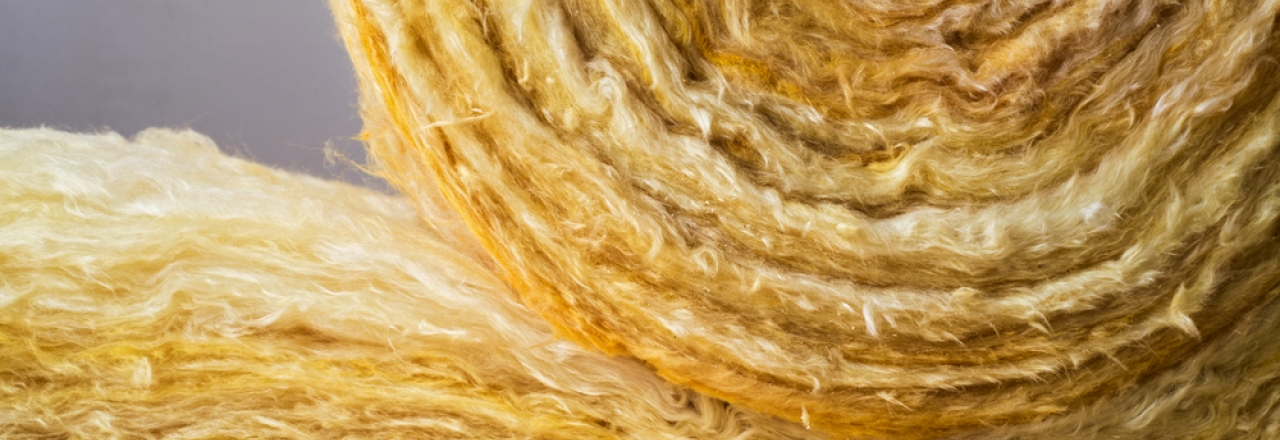roll of mineral wool insulation on unfinished wood floor