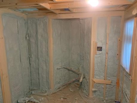 spray foam tiny house lower level walls
